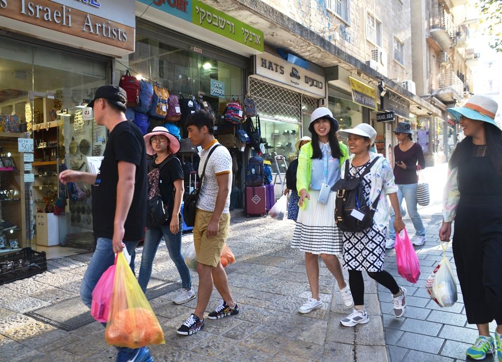 Chinese tourists shopping on Ben Yehuda Street