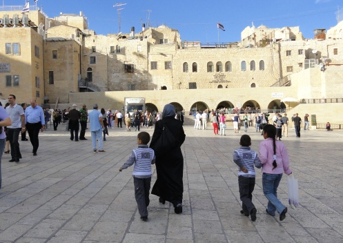 Muslim woman with children wailing wall plaza