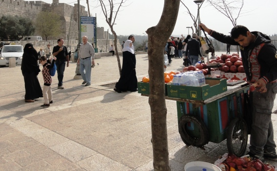 Muslim woman walking in Old City wearing hijab