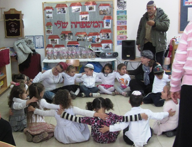 children sitting and singing
