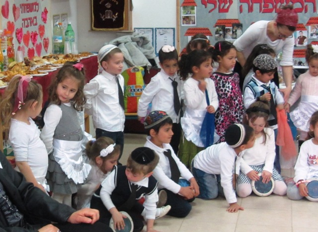 children singing in classroom