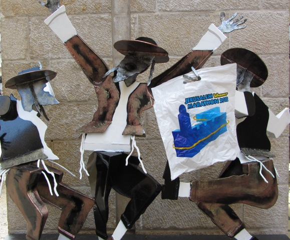 """metal sculpture"", ""art"", ""men dancing', ""Jerusalem marathon pictures"""