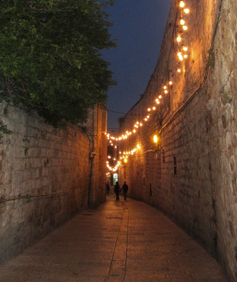 """lights above narrow street"" , ""J Street"""