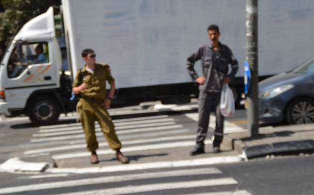 Israel soldier and Palestinian