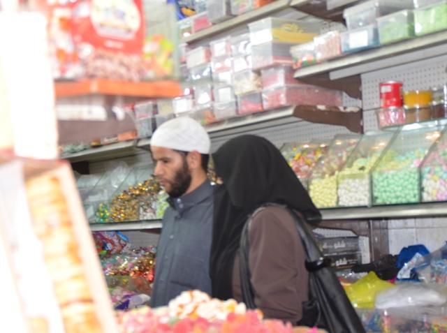 Arab woman and man, nijab