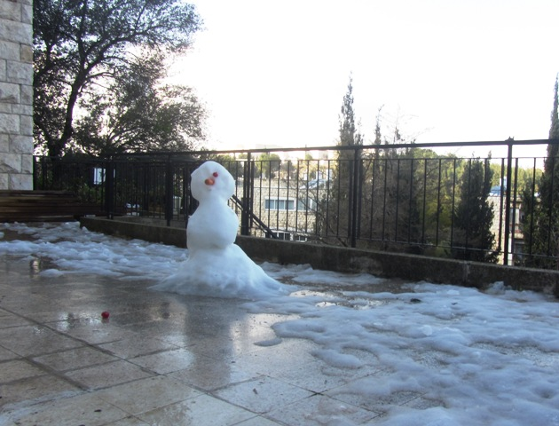 snowman melting, Jerusalem photo