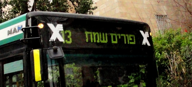 Purim sign on bus