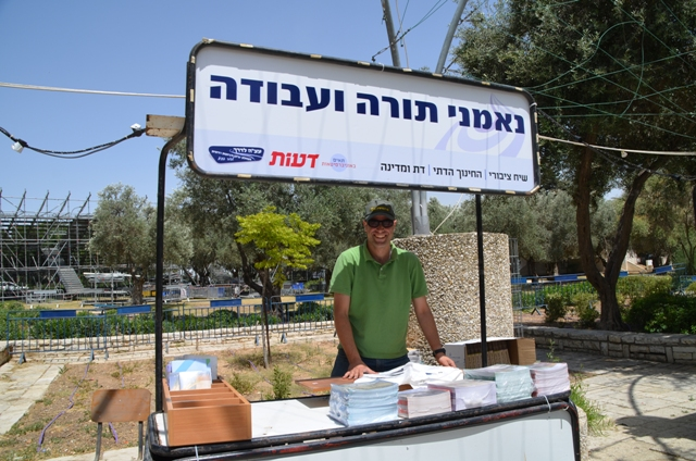 man selling books at park image