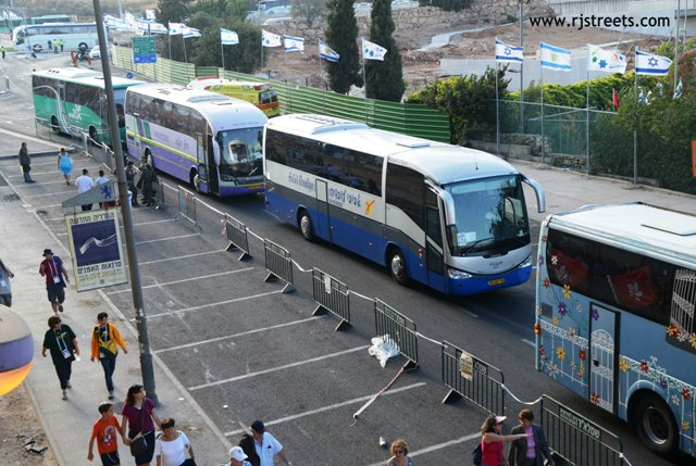 photo buses lined up at Teddy Stadium