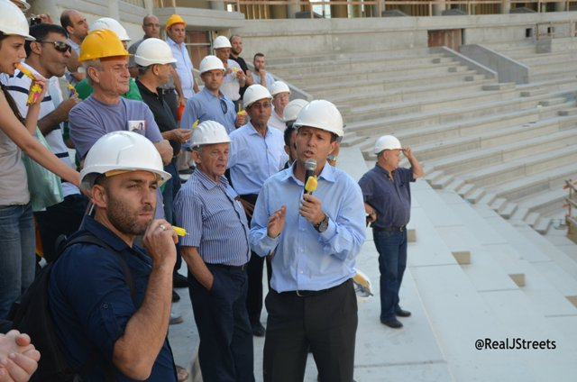 Hard hats in construction stie, sports arena Jerusalem