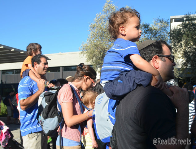 two little boys on shoulders to see music at Israel Museum,