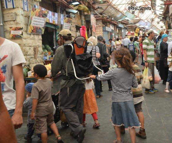 people in the Jerusalem market, shuk photo