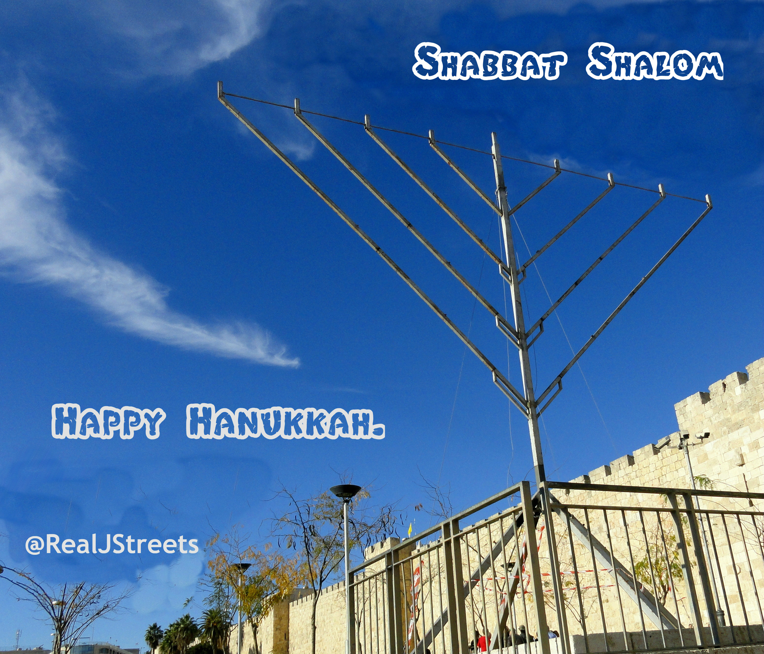 sign Shabat shalom and Hanukkah, photo large chanukiah at Jaffa Gate, picture large menorah