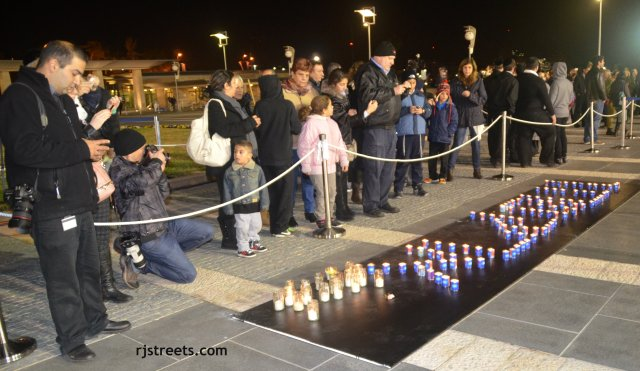 image memorial candles, picture candles spelling out name. photo Ariel sharon funeral