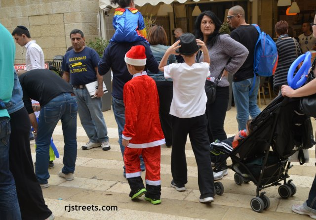 image boy dressed in santa outfit, photo Purim costuem, picture Purim