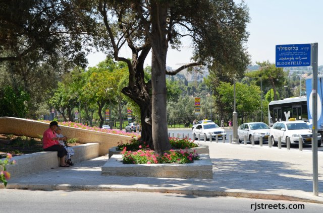 image two women sitting on bench in jerusalem