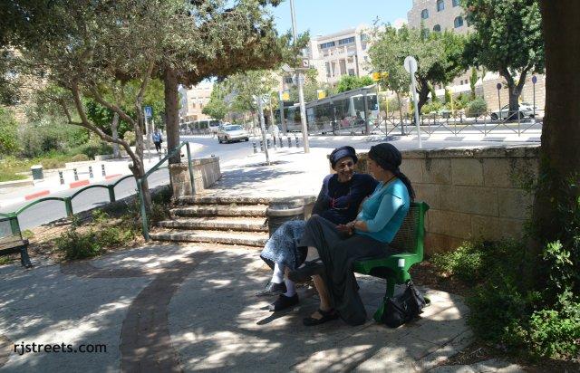 two women sitting in shade in Jerusalem, israel
