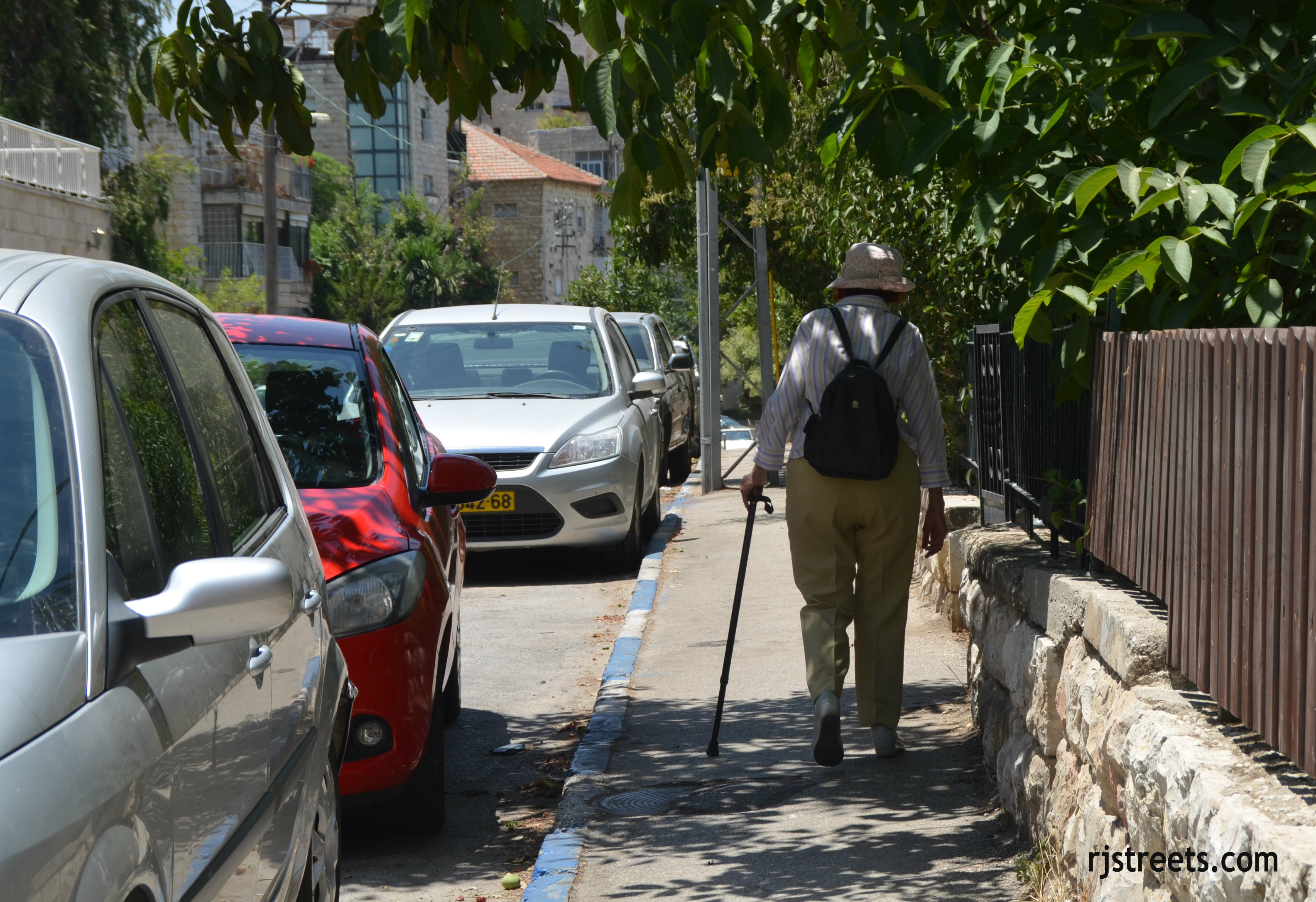 image woman walking with cane, photo Jerusalem street scene