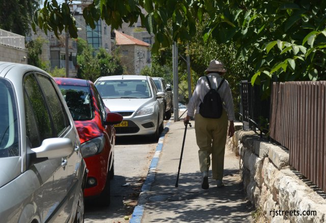 image woman walking with cane, photo Jerusalem street scene