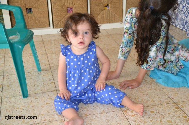image child sitting on floor
