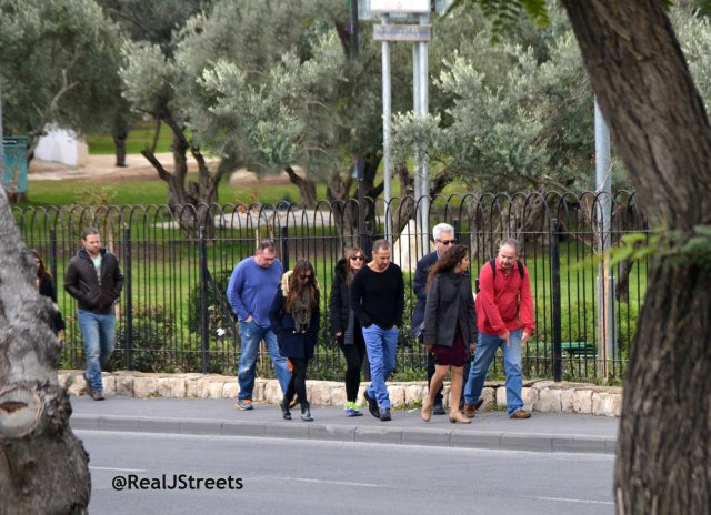 image people walking near streets