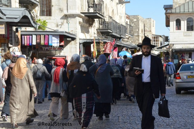 people walking in old city