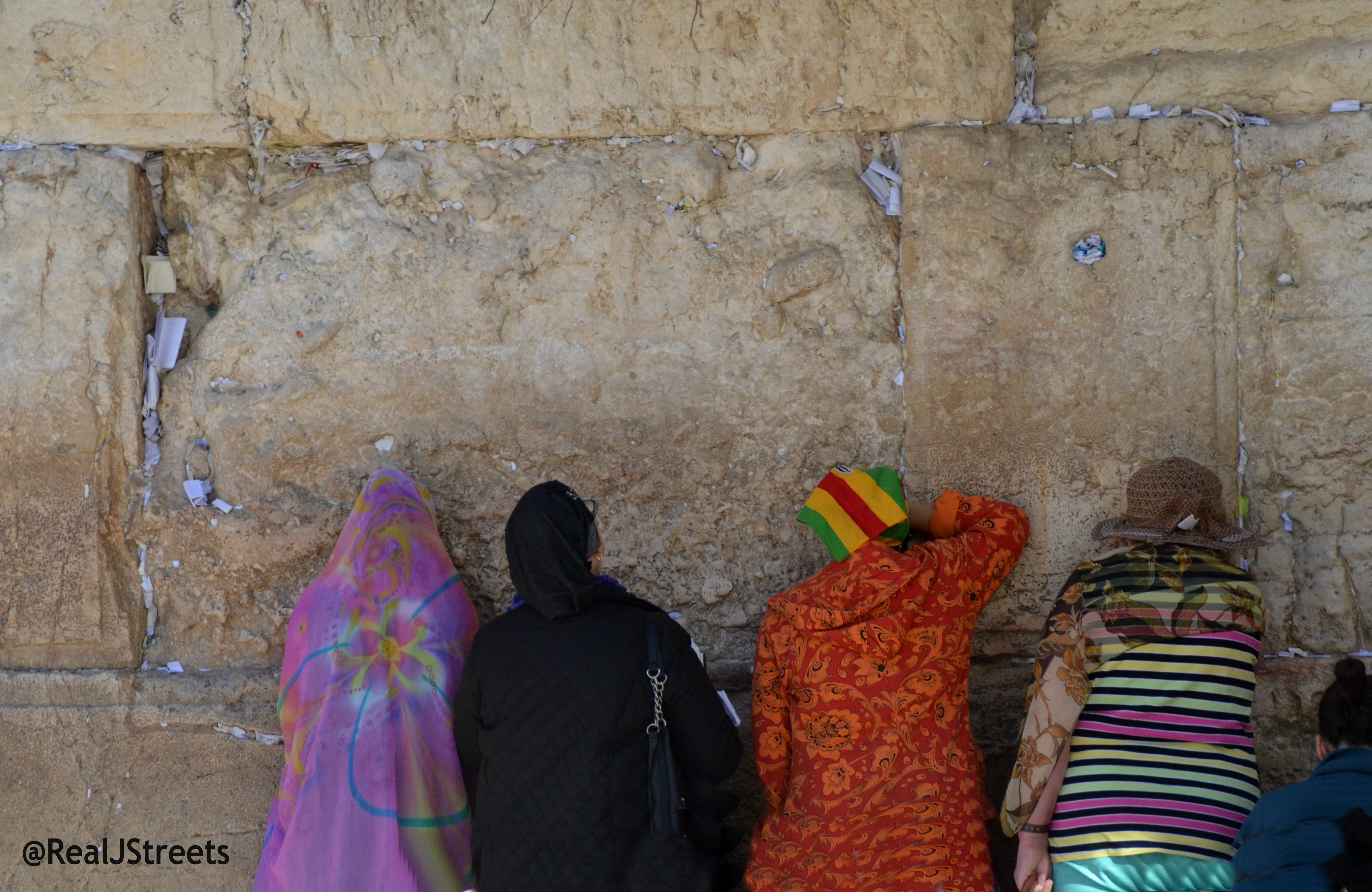 image women in colorful clothing at kotel
