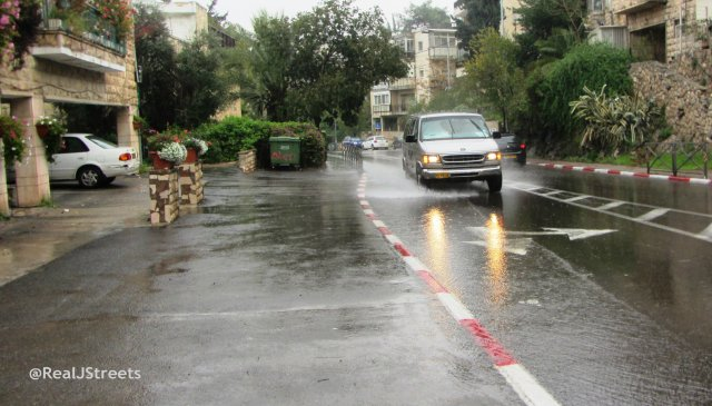 wet streets and splashing cars