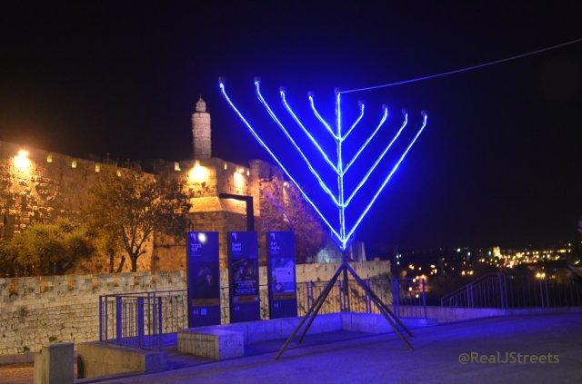 image menorah lit at night Old City