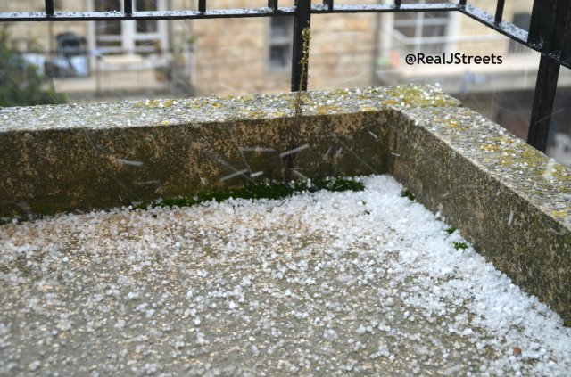photo hail stones on ground