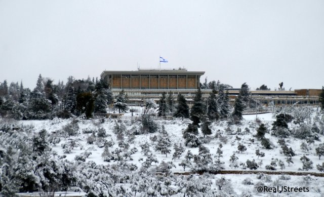 snow covering ground by Knesset