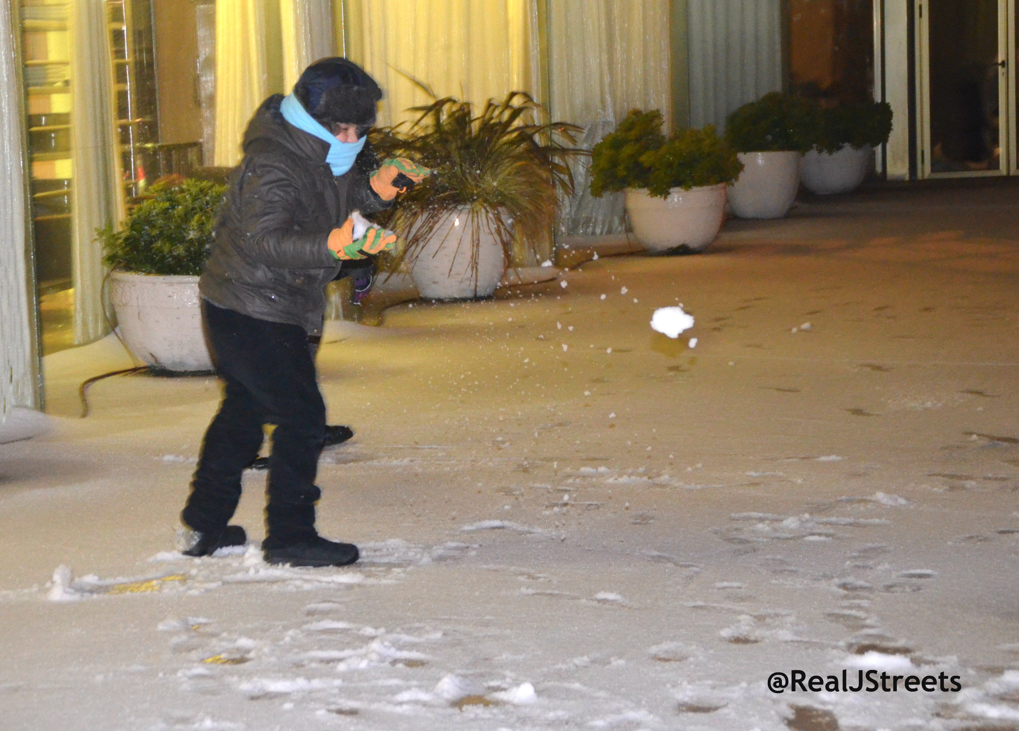 boy throwing snowball in Jerusalem