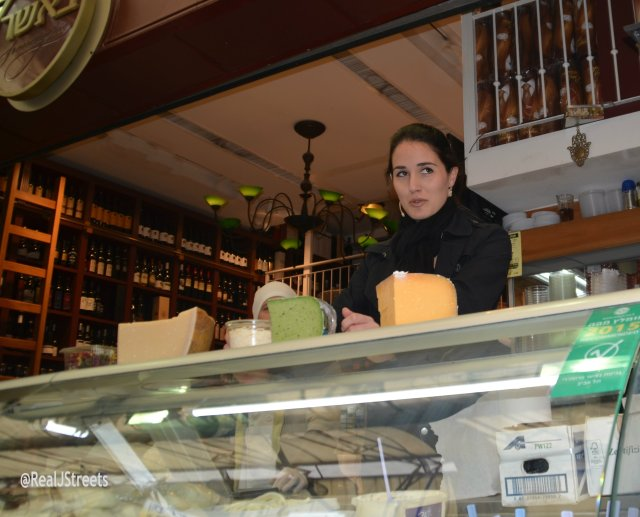 Israel opera singer at cheese shop in shuk