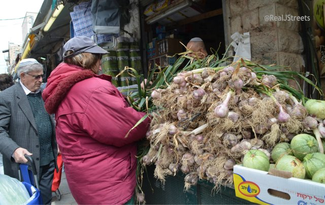 fresh garlic piled high in the shuk