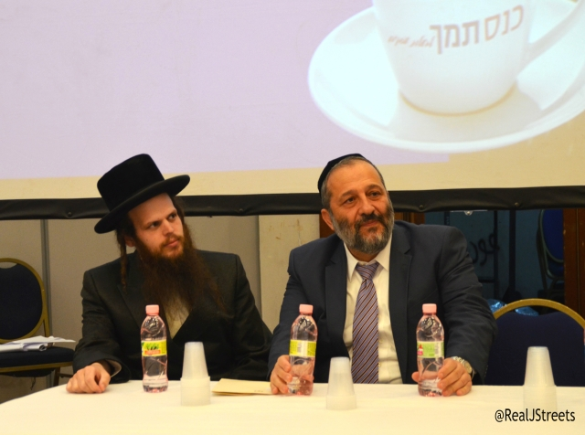 Issamar Ginzberg sitting with Aryeh Deri