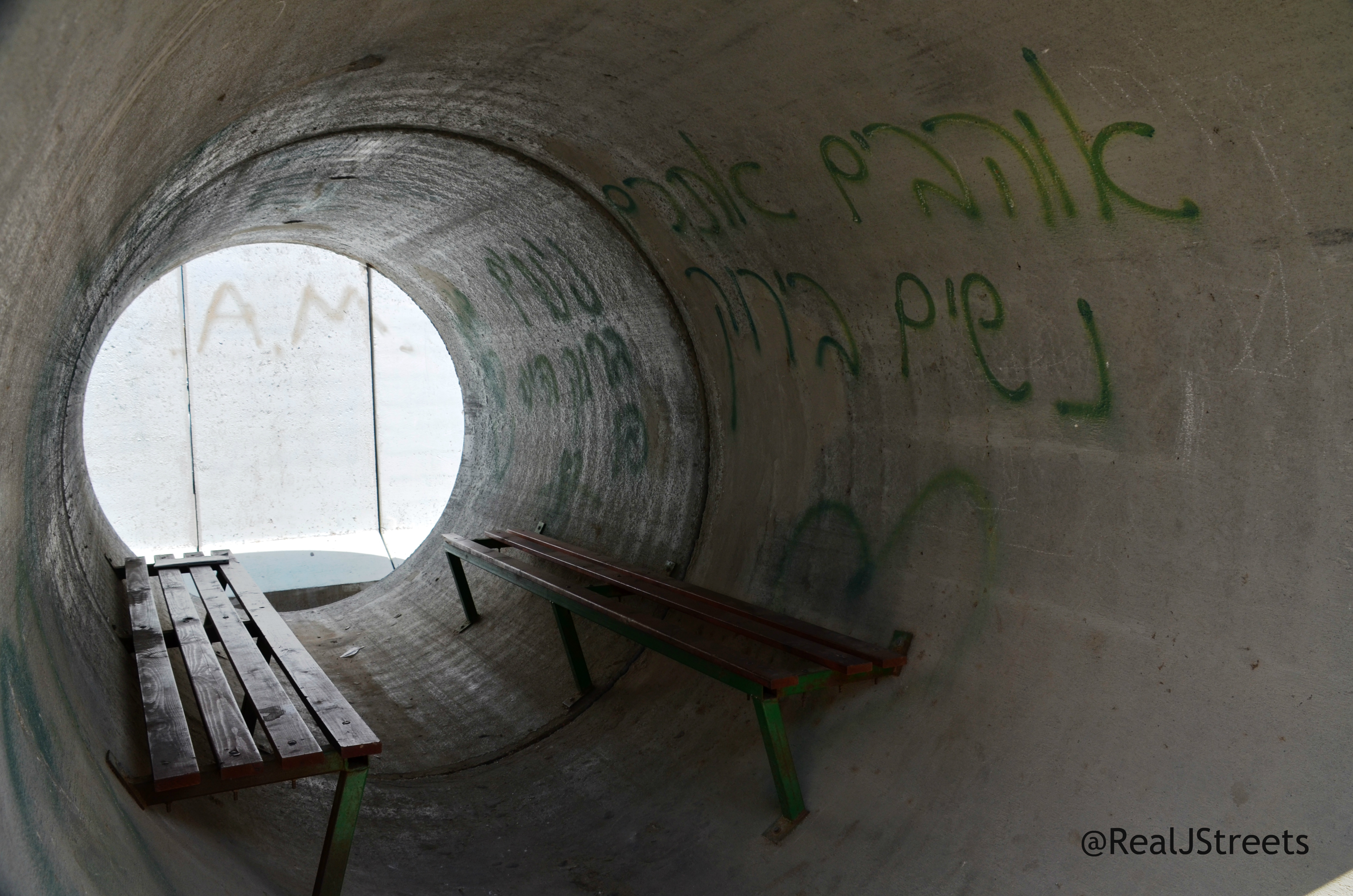 inside of pipe used as bomb shelter