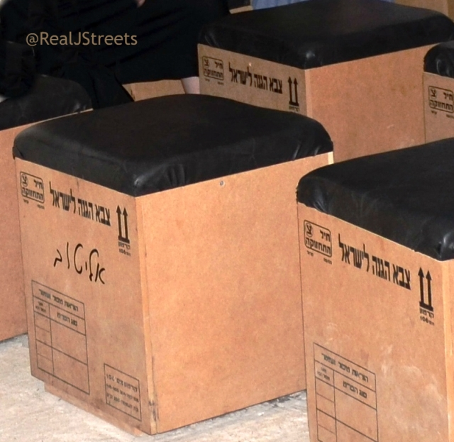 seats in Gush Ktif Museum made form moving boxes