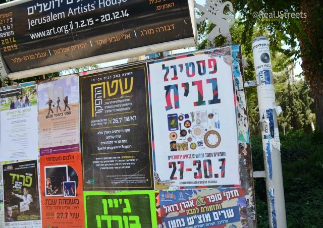 signs hung for summer programs on Jerusalem  streets