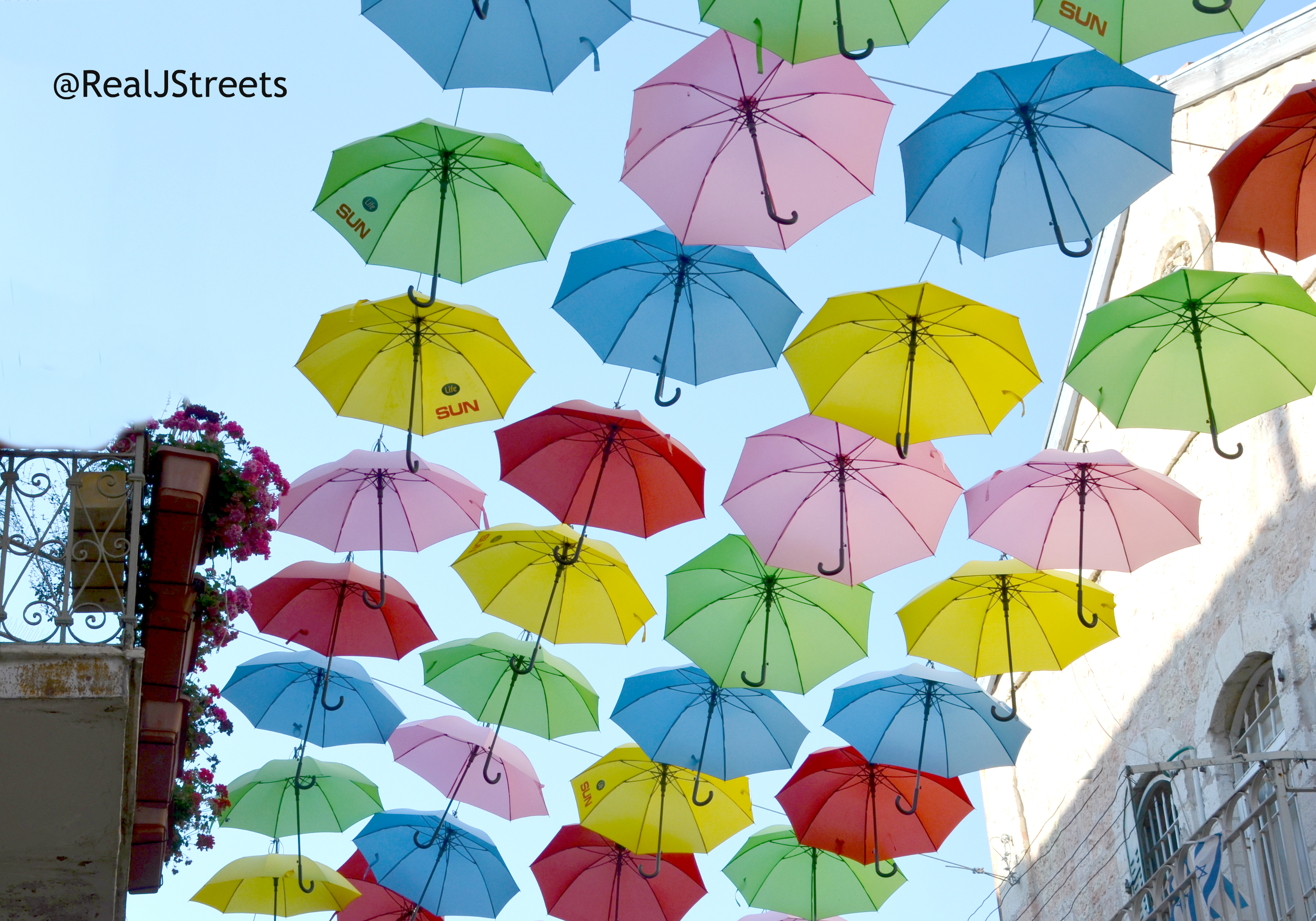 Jerusalem umbrellas over street