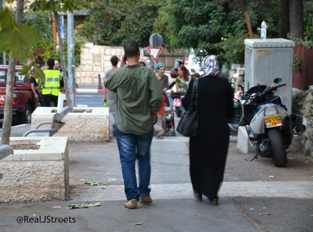 Muslim man and woman going to Emek REaim street