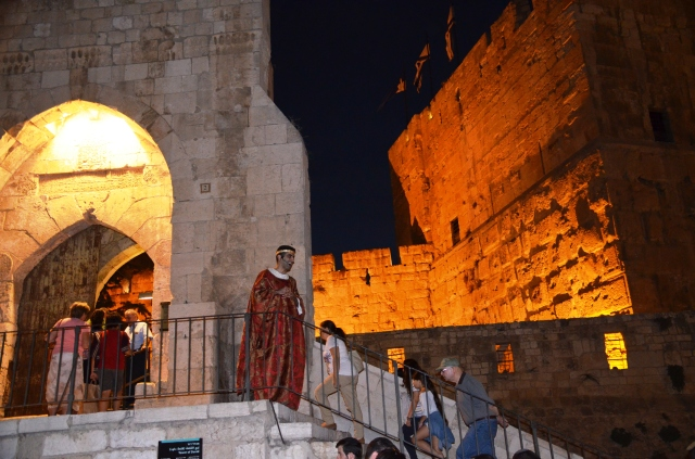 actor welcomes visitors to Tower of David