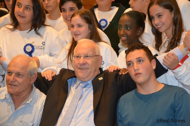 Rivlin posed photo with logo