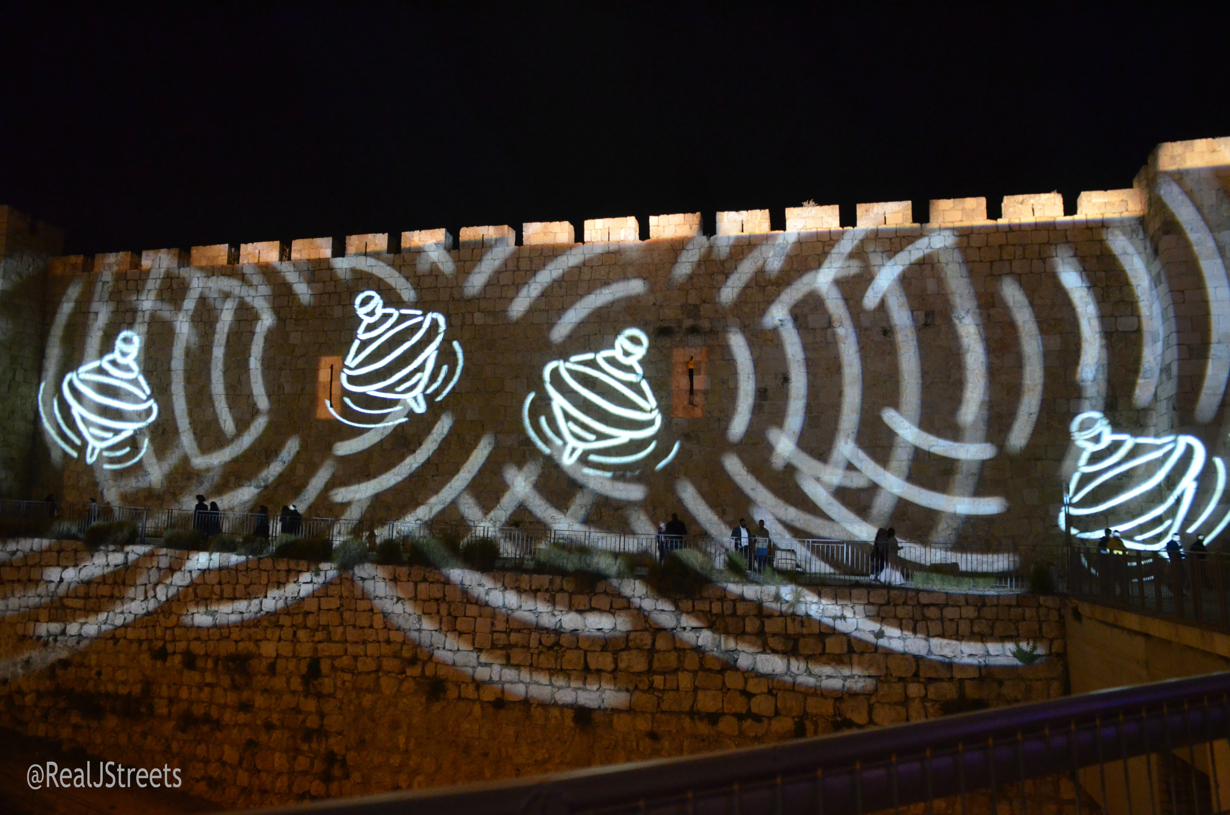 lights on wall of old city