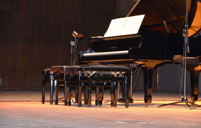 grand piano with 4 stools