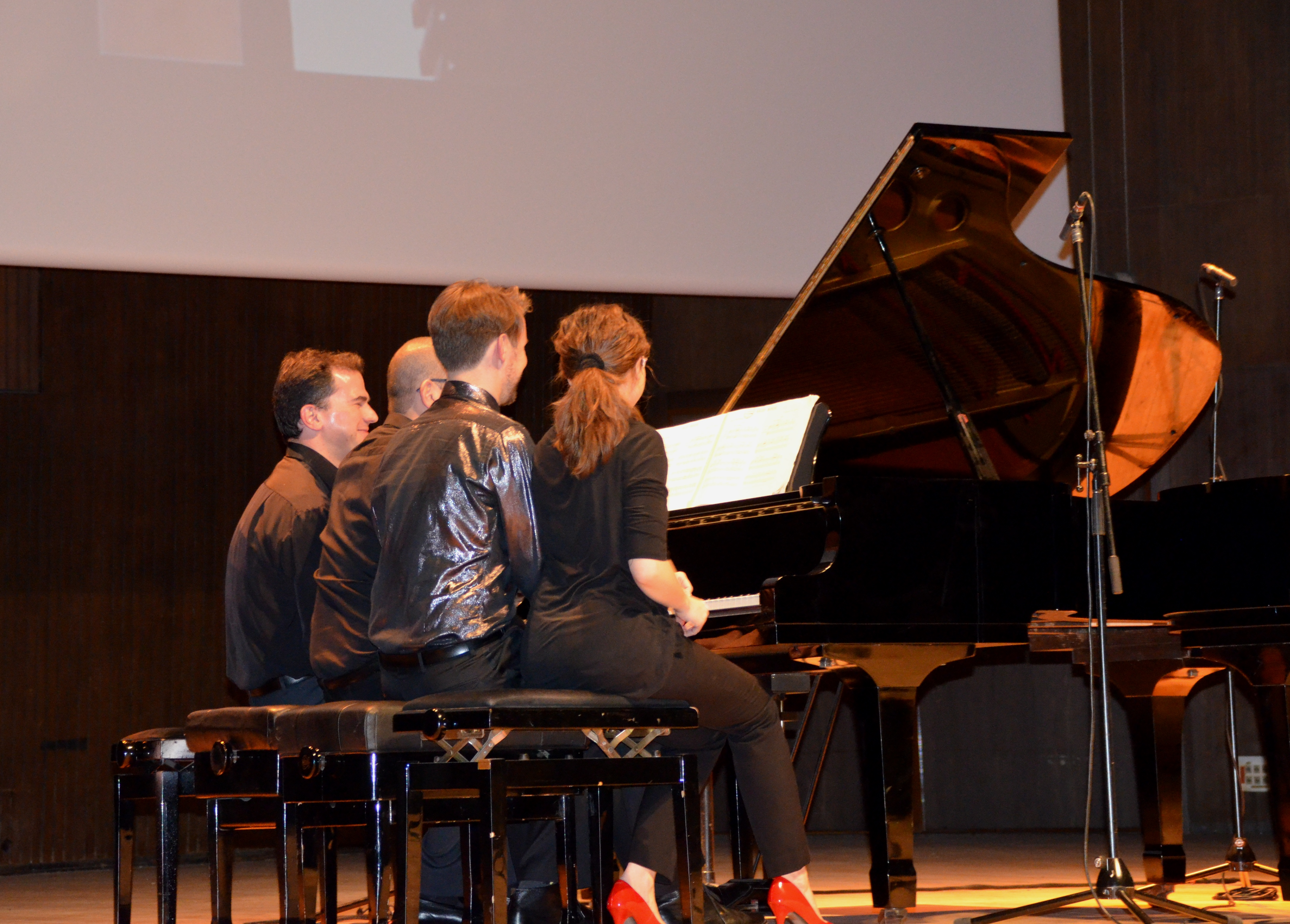 piano with four players
