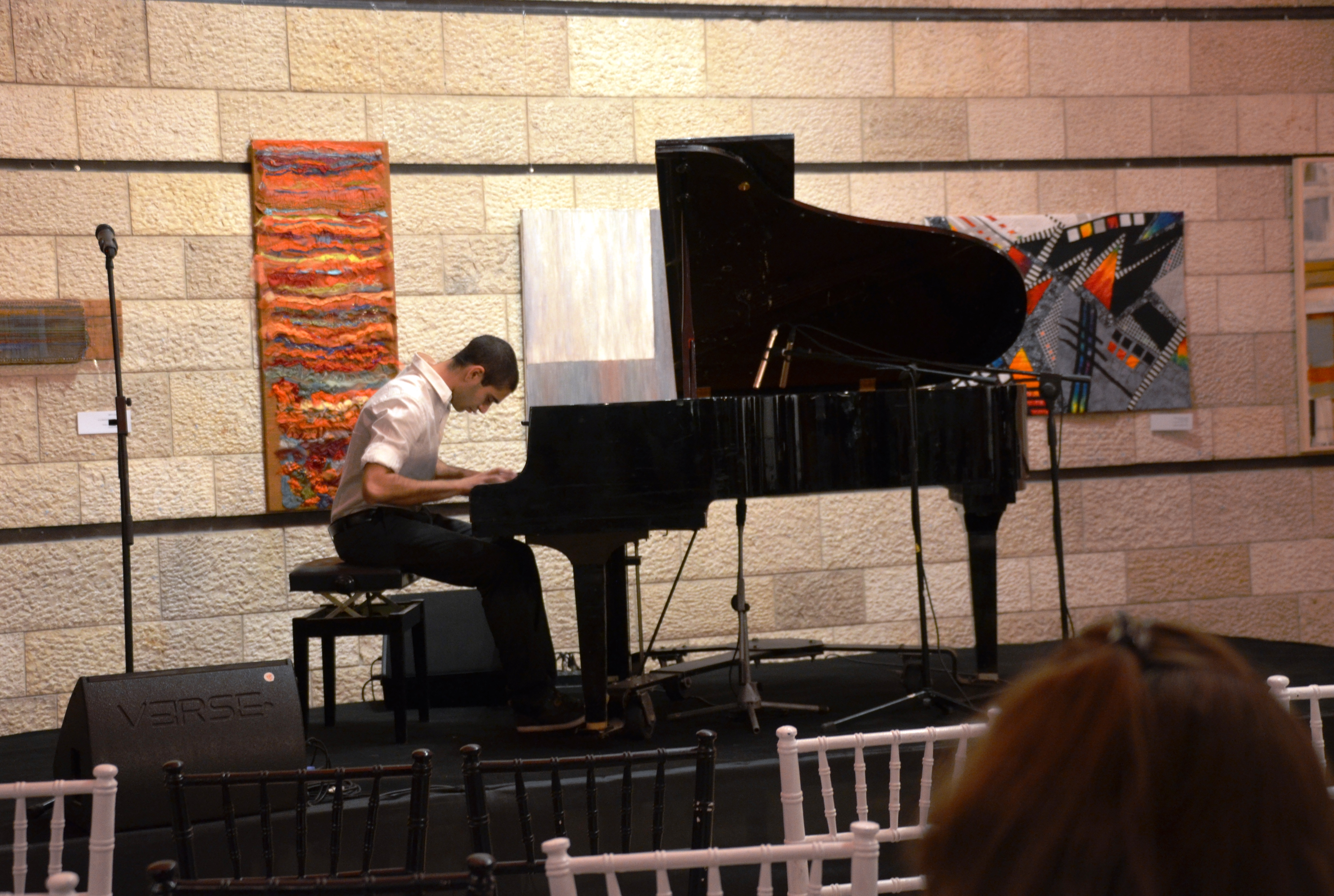 student playing piano in lobby of Jerusalem Theater