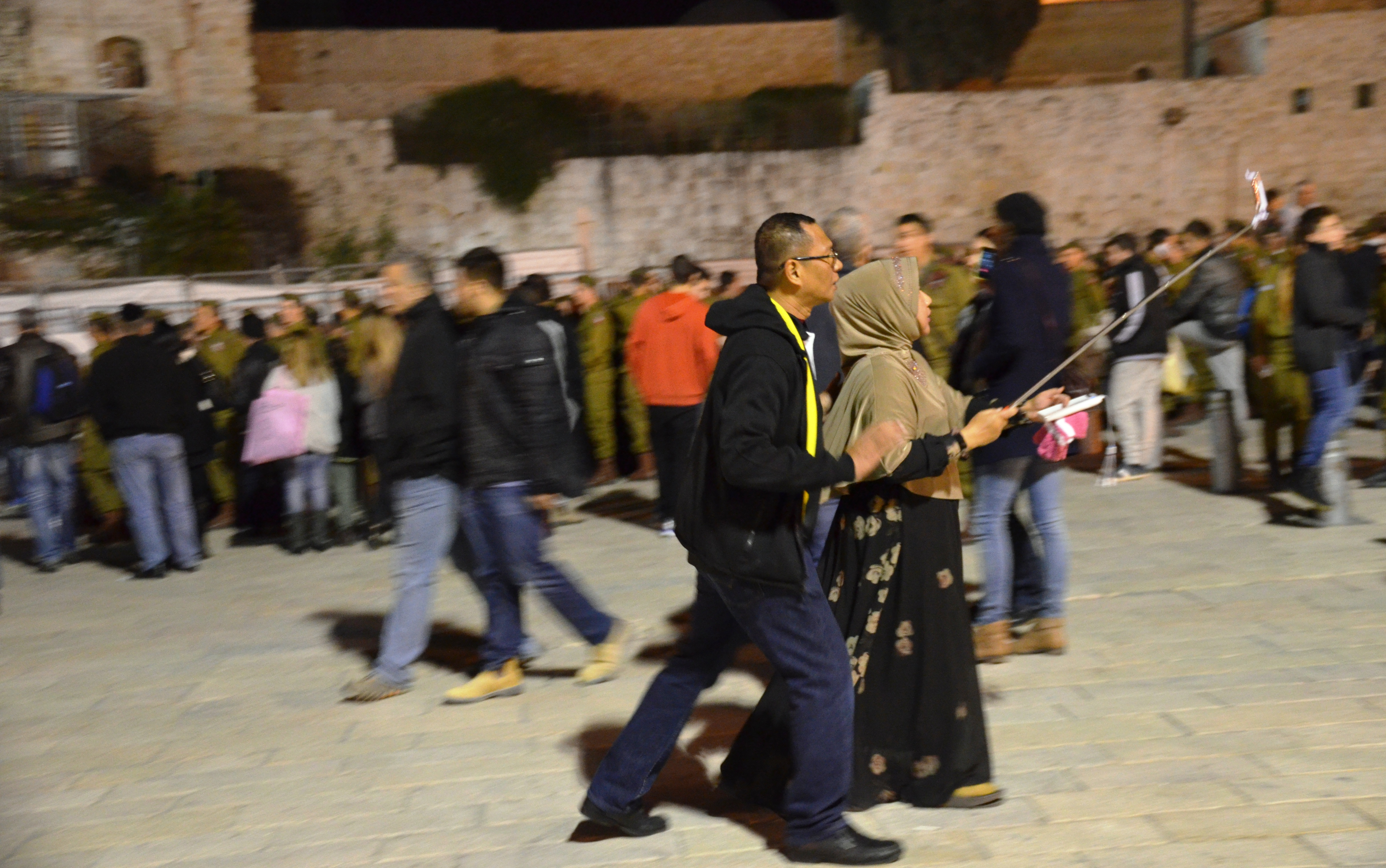 watermarked Muslim taking selfie at Western wall