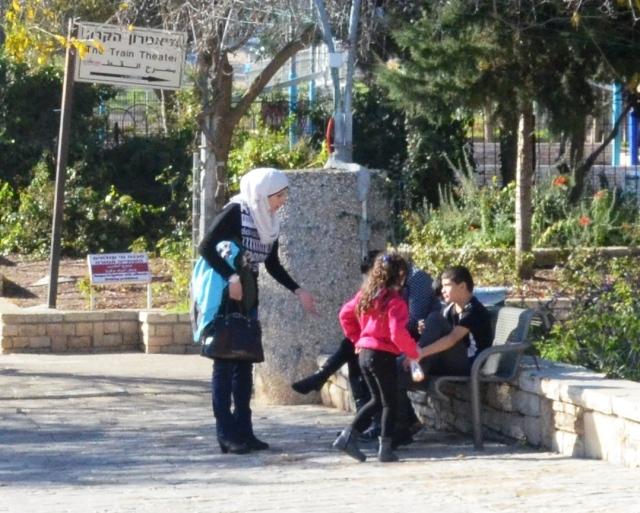 Jerusalem park arab woman