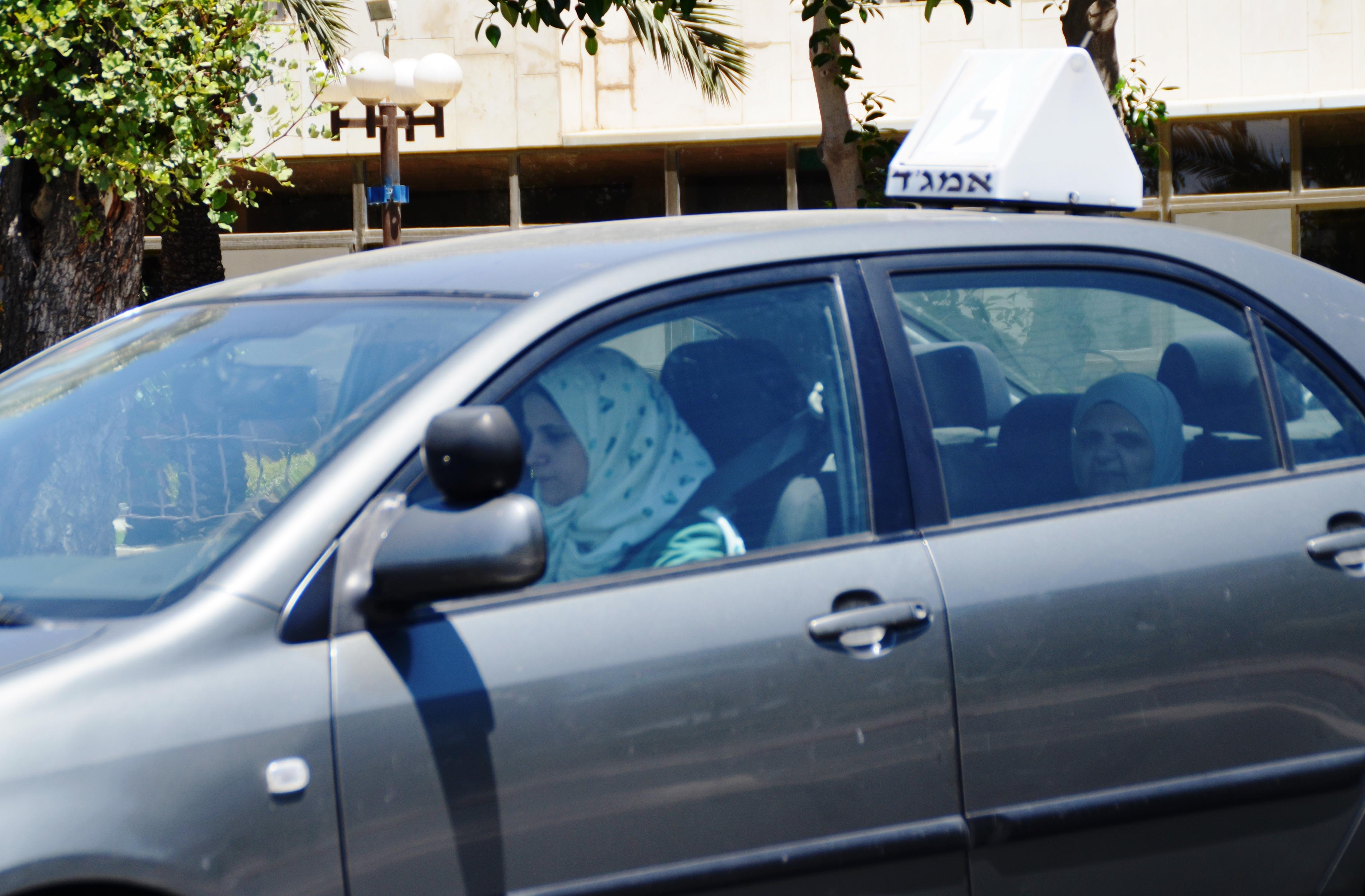 Arab girl driving a car