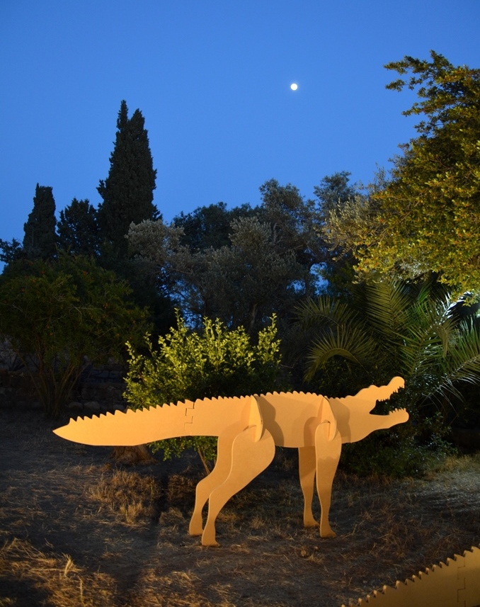 Hansen House gardens at night with full moon and animal lit for Design week festival